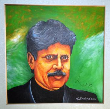 The Cricket Legend, Kapil Dev signs on the portrait created by Tulirekha Deb after unveiling it. at Royal Global School, Guwahati.